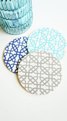 Our Round Coated Fabric Drink Coasters feature cotton prints that have been hand laminated and adhered to a high quality cork coaster. A set of four coasters in the shown in either navy, gray, or turquoise