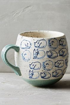 Thanks to Missy C, I purchased the dark turquoise shade online :) || Curled up cat study mug || 16 oz rounded stoneware $14 by Leah Goren at Anthropologie