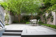 A peaceful color palette included bluestone pavers, zinc on the retaining walls, and a bleached cedar fence.