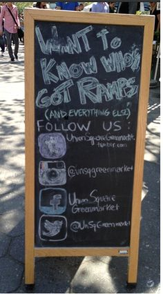 New York City green market vendor encourages social media engagement using a chalkboard.