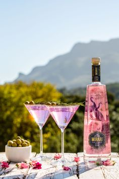 Dirty Pink Martini  50ml Mirari Pink Damask Rose Gin 15ml Dry Vermouth 2 tsps. Olive Brine Olives & Rosemary to garnish