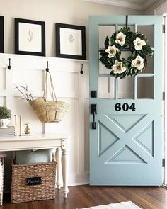 Love this robins egg blue front door with the board and batten in the entryway