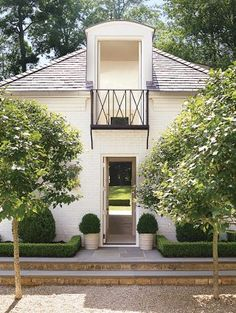 Traditional Outdoor Space by Suzanne Kasler Interiors and William T. Baker & Associates Ltd. in Atlanta, Georgia