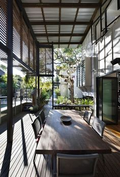 wood, metal, glass porch by syzygy