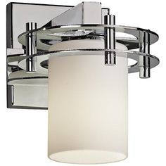 This simple yet striking modern one-light sconce is a mix of opal glass and glistening polished chrome.