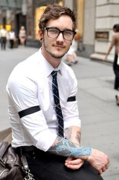 He looks sooo much like a Ph.D student who gave my course a lecture not long ago.    Also, tattoo'd men? Absolutely!