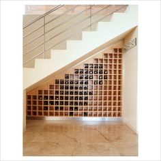GAP Interiors - View of wine bottles on shelf under staircase - Picture library specialising in Interiors, Lifestyle & Homes
