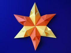 Stella di cuori 2 (6 punte) - Star of hearts 2 (six-pointed). Modular origami, no cuts, no glue, 6 squares of paper, 10,5 cm x 10,5 cm. Designed and folded by Francesco Guarnieri, June 2012. CP: http://guarnieri-origami.blogspot.it/2013/02/stella-di-cuori-2.html.