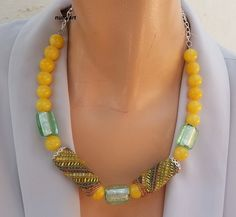 Statement necklace with spiral beaded beads and yellow jade