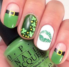 I like the white nail with the green kiss on it.