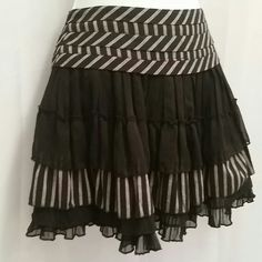 "Black & Grey Stripes Ruffles Mini Skirt  HP Summer into Fall Fashion @babscloset   Black and grey stripe mini skirt. Striped black & tan cotton with pleated black chiffon. Featuring contrasting bias stripe detail at waist. Layers of sheer pleated ruffle and stripes.  Fully lined, invisible side zipper closure.  100% cotton  lining 100% polyester  28"" waist 88"" sweep 14"" overall length Forever 21 Skirts Mini"