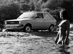 Audi 50 GL and lady in water