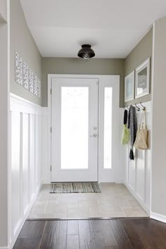 Reader Redesign: Welcome Home Makeover | Young House Love , dark wood floors white panelling and orb metalwork