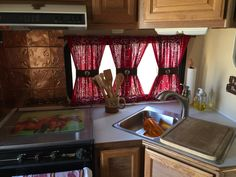 Love the kitchen with bandana curtains and copper wall tiles
