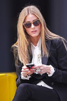 love the rings, her hair, glasses and black suit.  Very powerful image of a woman!