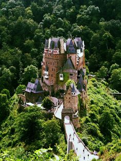 Burg Eltz | Germany ....a castle on top of a hill/ a house in the mountains