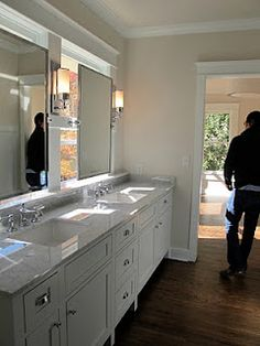 Bathroom Mirrors Over Windows mirror on barn door track so you can pull it over the sink when