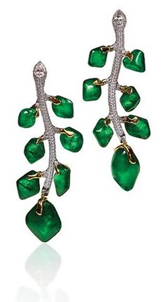 Branch Emerald Earrings The most beautiful, most radiant and most intense Green that can possibly be imagined can be found in only an Emerald. 88.57 carats of Cabochon Emeralds drip from 18K White Gold branch earrings encrusted with 3.78 carats of Pear Shape and Round Brilliant Collection VS quality diamonds.
