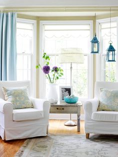 bay windows... love the way the drapes are hung straight in front of the window instead of along each window.  AND I like the sweet little white shade hung right up in the window