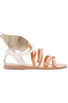 Ancient Greek Sandals' 'Nephele' style is designed with the brand's signature wings - this time in metallic gold leather. Ideal for wearing on city strolls or to the beach, this comfortable pair is made from sand and white leather with a flexible rubber sole. Adjust the polished buckle to find your perfect fit.