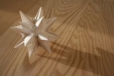 Kusudama origami star A great tutorial is further down the page, disguised as a skating video ;)
