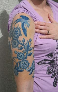 Bluebird blue ink half sleeve tattoo, very cool.