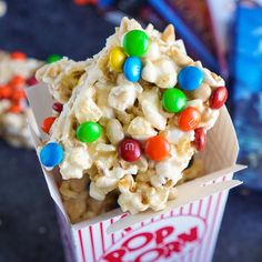 These Movie Night Marshmallow Treats are so easy to whip up! A buttery marshmallow treat loaded up with popcorn and peanuts!