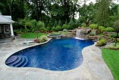 Accessories & furniture,Appealing Backyard With Green Grass Area Feat Underground Swimming Pool And Stone Waterfall Ornament Complete With Round Jacuzzi Area Combine Flagstone Deck,Amazing Underground Swimming Pool Design