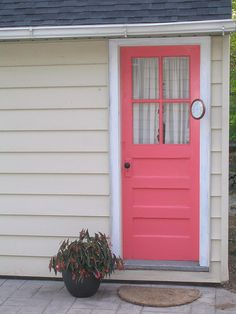 The Salmon Pink Door?, A small patio separates the garage and creates a private area for dinning reading etc. Let me know what you think? Too bold for New England? Patio Deck Designs, Small Patio, Dream Decor, My Happy Place, Exterior Colors, Separates, Photo Library, Pantone, Decks