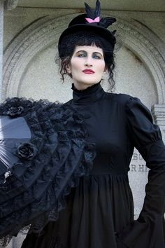"Angela wearing our Short Victorian Mourning Dress & Black Rose Parasol. Angela's picture is featured in a gorgeous book of photography ""Beauty in Darkness"" by Laura Dark."