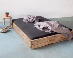 a diy bed made from reclaimed wood. Black Bedroom Furniture Sets. Home Design Ideas