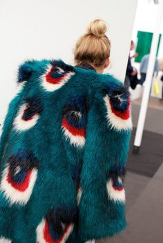 this coat with a bun, nice relax for something so fabulous, this keeps it real