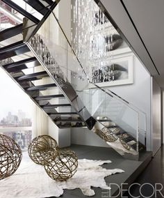 The stairs at a family's modern Manhattan duplex could double as a work of art.