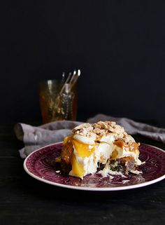 Postre Chaja, a Uruguayan meringue cake topped with cream, dulce de leche, fruit, and nuts