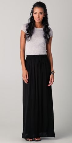 Black maxi skirt + grey T-shirt , add a statement necklace with gold accents + shades for a grunge glamour look <3