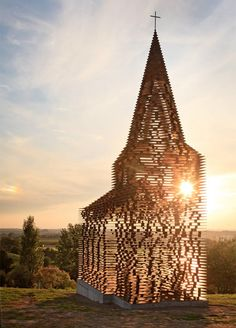 Ten metre-high see-through church in Limburg, Belgium, constructed from 100 stacked layers of weathered steel plates. The project is called 'Reading between the Lines' by the duo Gijs Van Vaerenbergh, a collaboration between Belgian architects Pieterjan Gijs and Arnout Van Vaerenbergh.