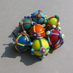 """Items similar to Handmade lampwork glass bead set """"Abstract"""" in vibrant colors like blue, yellow, red, orange, green by Flamejewels on Etsy Polymer Beads, Clay Beads, Lampwork Beads, Beads Of Courage, Red And Pink, Blue Yellow, Orange, Beads Pictures, Bead Jewellery"""