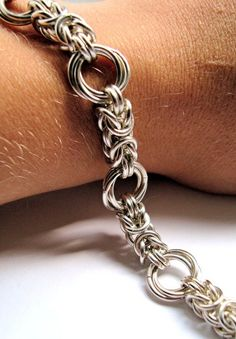 Byzantine rose chain maille bracelet...this would be awesome with stones in the large rings too! #chainmaille