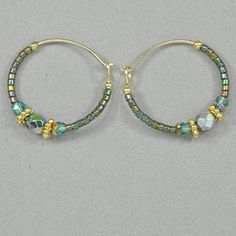 Everyone needs some go-to pieces of jewelry. Wear these colorful hoops anywhere, from a night out to a day of hiking and sightseeing. Bohemian glass on gold filled hoops.