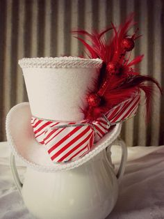 Red and White Candy Stripe Christmas, Holiday Mini Top Hat, Tiny Top Hat. $28.00, via Etsy.