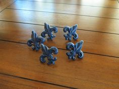"""Fleur De Lis Cast Iron Knobs Navy Blue or Pick Color Cabinet Drawer Door Pulls French Country Dresser Handles Furniture Hardware. This listing is for one (1) lovely Fleur de Lis dresser pull / knob custom painted in Navy Blue (as shown) or a color of your choice. Gorgeous shabby chic drawer handles are made of cast iron and can be done in 40+ colors with distressed finish. Measures about 2 1/2"""" (6.3 centimeters) wide x 2 1/2"""" (6.3 centimeters) high and comes with a 1"""" (2.5 centimeters)..."""