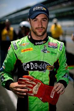 Hinch holding Greg Moore's gloves after qualifying first round at IMS. Moore never got to drive there but now he has. Amazing Canadian moment.  (2012)