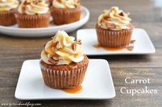Carrot cupcakes topped with cream cheese frosting, caramel, and chopped pecans