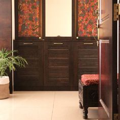 Woodwork pieces that are pasted with indigenous fabric and sealed | Home Tour: A beautiful Antique Modern home in Bangalore ~ The Keybunch Decor Blog Makes You Beautiful, Beautiful Homes, Brick Cladding, Vintage Trunks, Indian Home Decor, Stone Flooring, Decorating Blogs, Wood Doors, House Tours