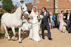 Jacquetta Wheeler and Allsopp lead the wedding party from the village square.