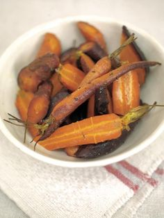 I love cooking any type of carrot in this way. By cooking them first covered by tinfoil, they steam and exchange flavours with the herbs and garlic. Then when you remove the foil they start to roast and sweeten. A really simple method but one that gives incredibly delicious results!