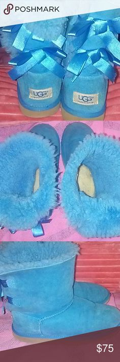 Looking to TRADE for size 7/7.5  UGGS Anyone wanting a pair of Blue Bailey Bow Uggs??!!??!!  I'd love to trade you these  for a pair of Uggs in a women's size 7 to 7.5 possibly even an 8. My daughter doesn't fit into these anymore and they're in great used condition!! (Hard to find!!) these CAN fit up to a woman's size 7!! I will even treat them with ugg product before shipping!!! Only serious inquiries plz!  And i don't want to trade for another brand! Any style or color considered UGG…