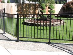 high black ornamental aluminum three rail fence posts on plate. This fence was not installed for containment. House With Porch, House Front, Third Rail, Fence Posts, Aluminum Fence, Rail Fence, Michigan, Deck, Plate
