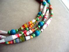 I think this paper bead necklace and all the vibrant colors is like of the happy feeling of opening a brand new box of bright crayons! I handmade each of the paper beads from ephemera.    This necklace:  - is 58 1/2 inches (148.6 cm) long.  -closes with a lobster clasp making it easy to wrap around your neck 2, 3 or 4 times depending on how you want to wear it.  -is made of handmade paper beads and accented with glass beads and seed beads.  - comes ready for gift giving in a handmade ori...