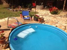 We decided to bury our 8' poly stock tank in the backyard to make it an in-ground pool or little spa really. We bought the stock tank s...